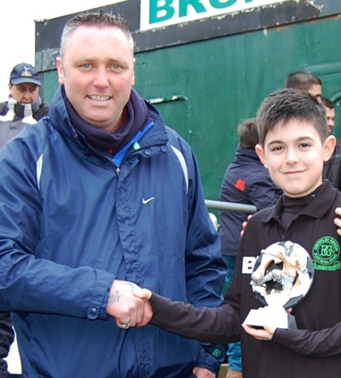 12.1.2013 Keith Montgomery presents Tommy with the player of the match award