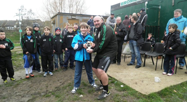 12.1.2013 Duncan presents Harry with the player of the match award