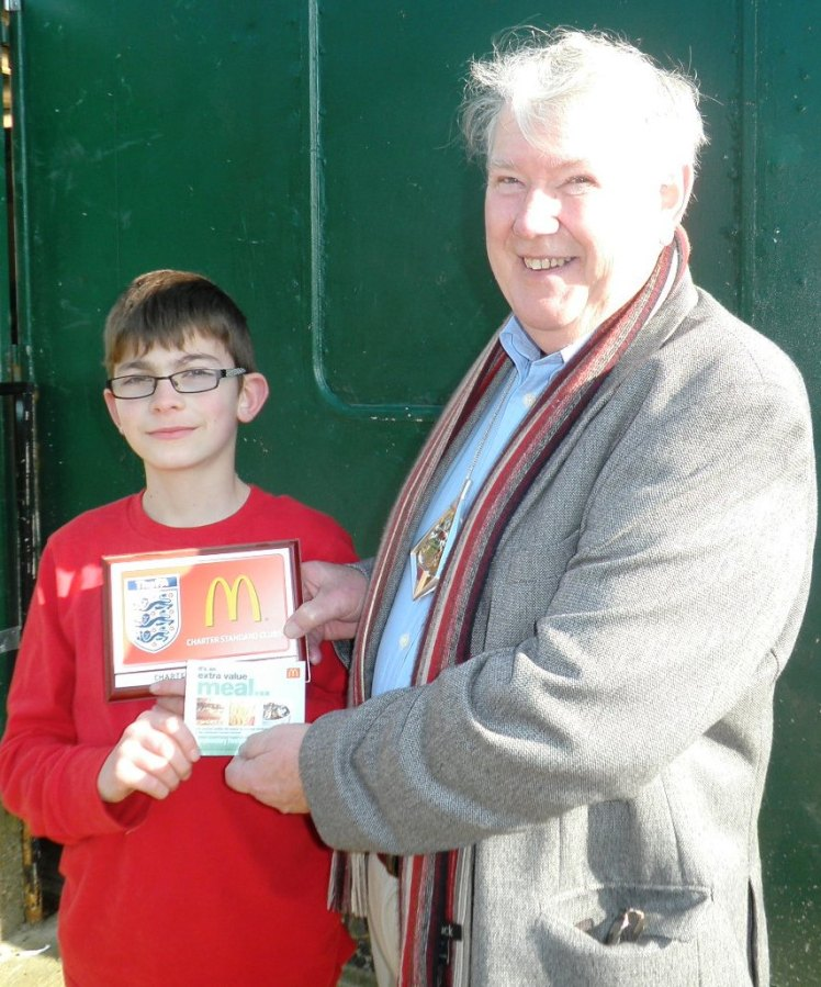 Curtis receives his McDonalds voucher from the Mayor for being Player of the Match in the 6-0 defeat of Wye