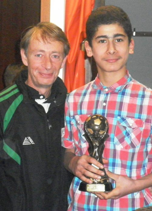 9.12.2012 Mazlum Aydin receives the Player of the Match award from Vice President Mark Day