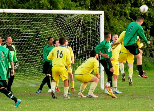 21.5.2013 Dalby heads for goal as visitors keeper Marcus Digby keeps an eye out