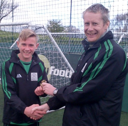 Harry receives his Player of the Match award from Simon