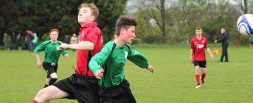 Matt Kirby and Cameron Lumsden challenge in midfield