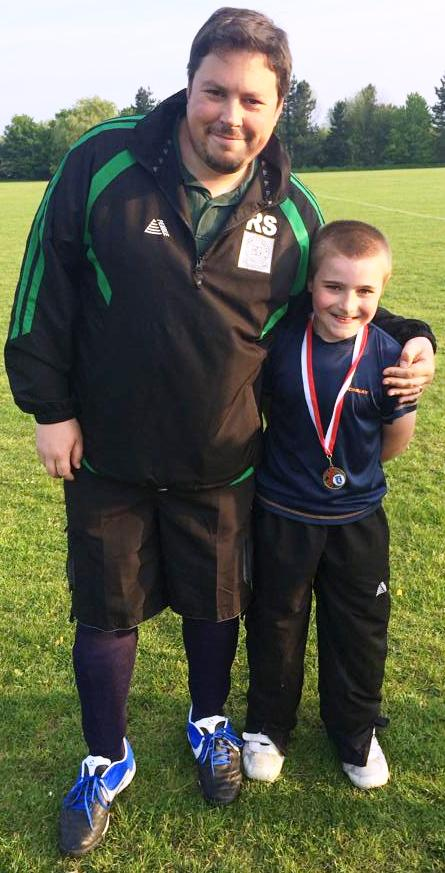 Ollie 'Twisty' Bell receiving his KDL medal from Rob