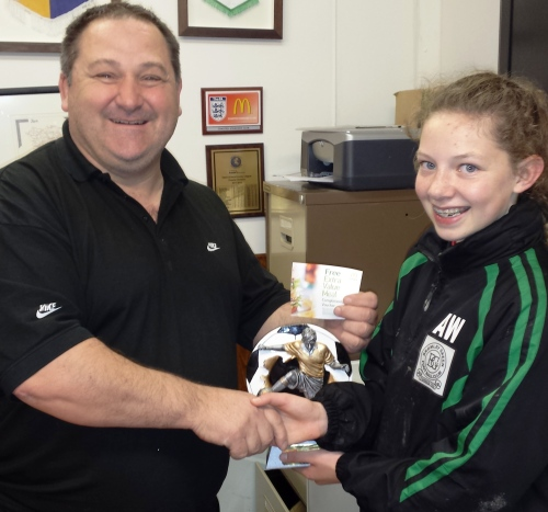 Steve Rollings presents Aileen Williams with the McDonalds award and meal voucher