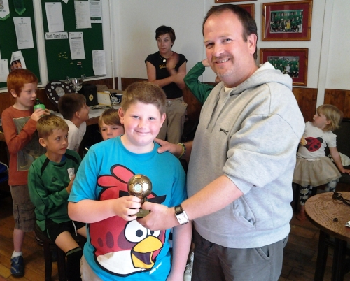 John Grace presents Matt with his award after the U10s did well at the Marsh Academy ... more photos on the main page