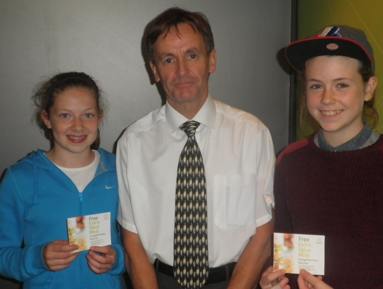 Aileen and Abi with their Player of the Match vouchers from Chris Symons at tonight's event