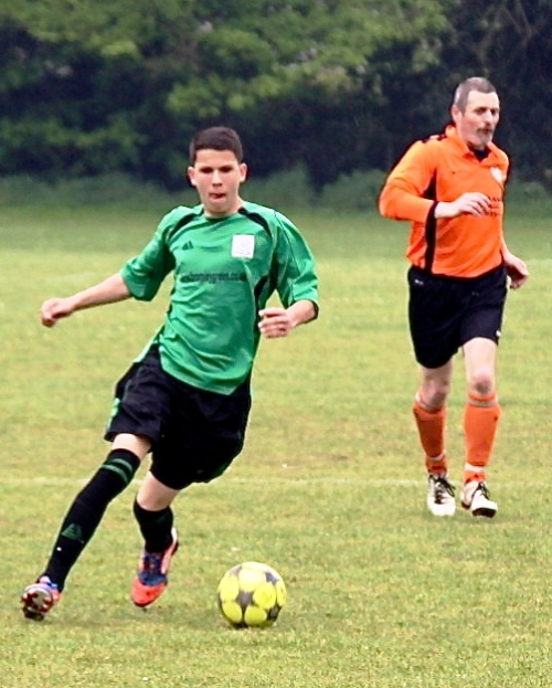 Miles Christian, who fired in a splendid goal, is pursued by former Ashford Dynamo and Bromley Green man Andy Towell