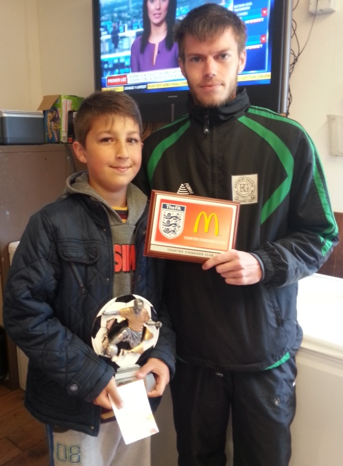Dilan receives his award and McDonalds voucher from Gary Penfold