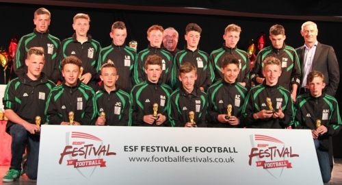 Last year's Butlins Tournament .The U15s squad receive their medals from Liverpool legend Ian Rush
