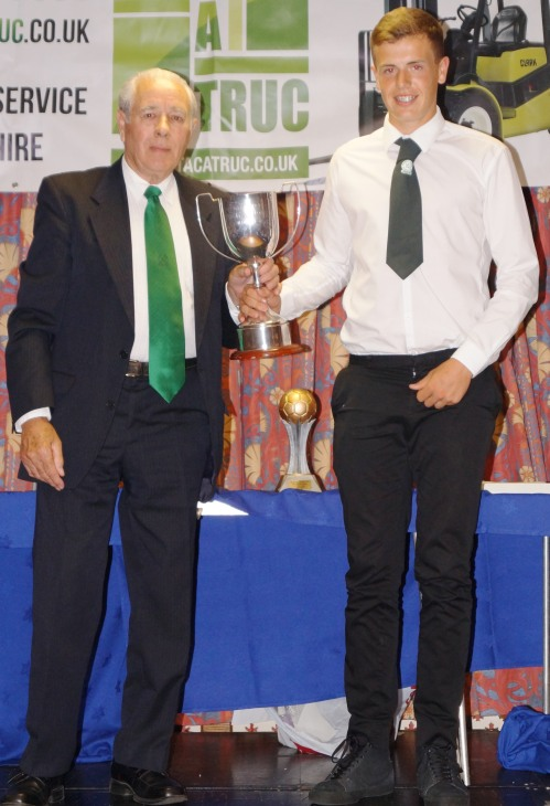Reece Chapman receives the Tommy Stafford Memorial Trophy for Youth Clubman from Jack Stafford