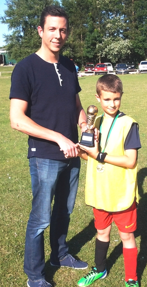 Big moment for Coleton as he receives the Youth Sportsmanship Award from Nick Rowe of Brailsfordrowe Accountants