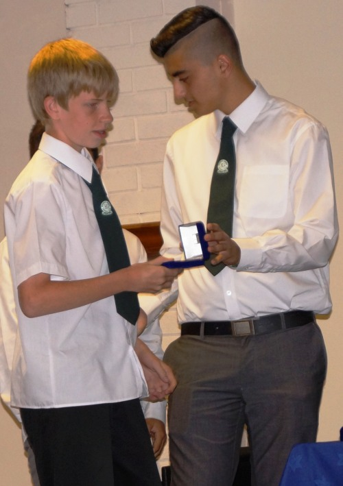 Aaron Maher ... another loyal clubman ... receives his cup medal from Josh