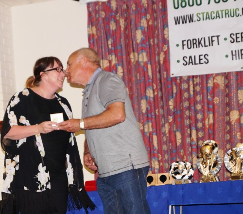 Dave spent most of the evening kissing the ladies ... anyway he said he had a good time! Here Sharon Jeffery is thanked for her work on behalf of the club, running raffles, helping with the bar, supplying free food and at this moment organising the World Cup draw
