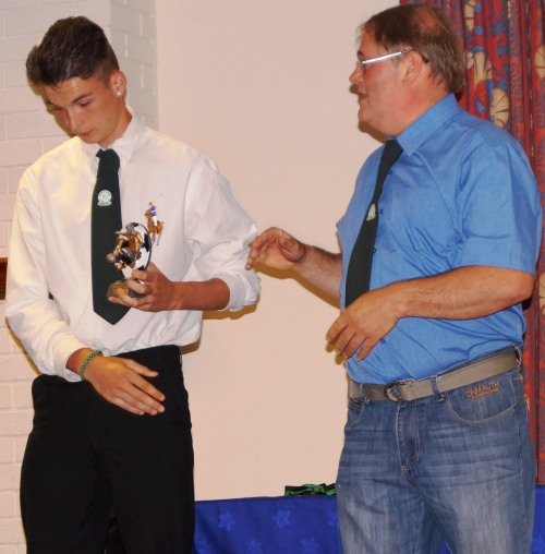 Tom is a worthy winner of the U15s Merit Award ... although he seems to want to leave the stage!