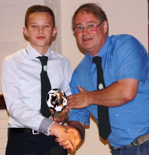 Kurtis Hooper, now bidding for a place in the U18s, receives the U16s Merit Award from Vice President Andrews