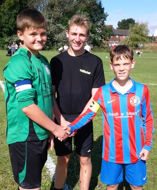 The captains with referee Josh Twyman before the U13 Colts game against New Romney