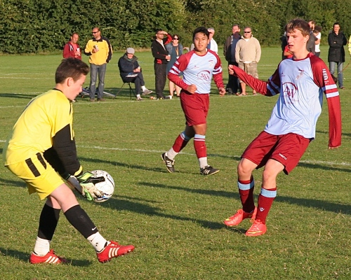 Louis gathers the ball safely