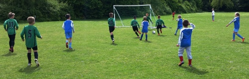 The Green U9s about to score during an impressive first half this morning