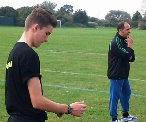 Referee Tom Messenger and Manager Guildo Bulla prepare for the big kick off