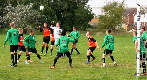 Tom Moon punches clear during today's Premier Division thriller at Waterside