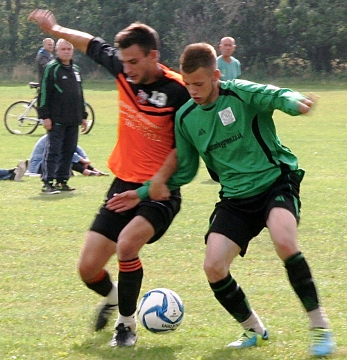 Joe Briffitt and Ben Barrett enjoy a tussle in a ding-dong affair which ended 3-3