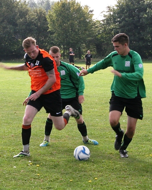 Marsh's Sam Lancaster and Green's captain Martyn Dalby in action