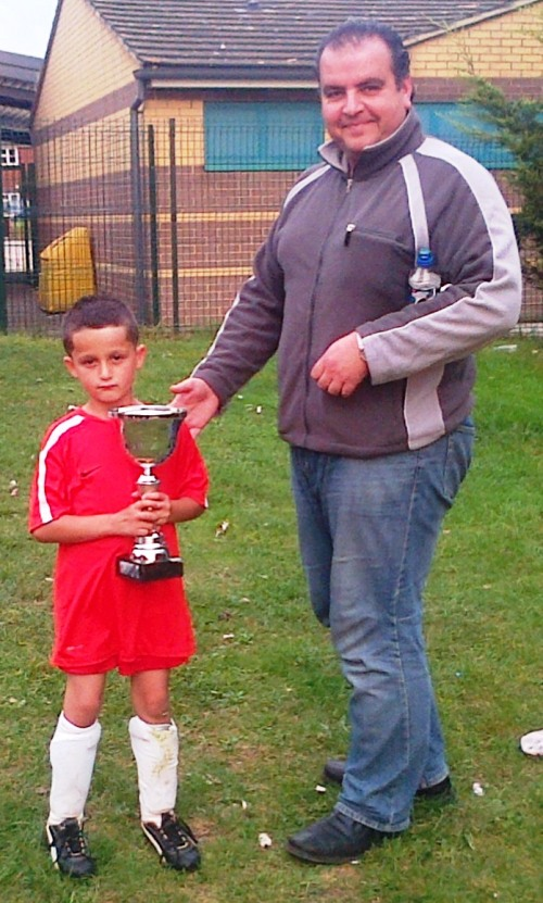 Old English Rose Player of the Match for the Under 8s at the weekend is Johnny, seen here with Khaled, our sponsor from Key Auto Trade