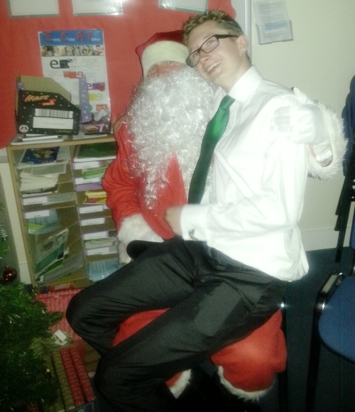 Well done to the Valiant adults that wore their club ties on Saturday ... here the 'overage' Charlie attempts to secure a present from Santa!