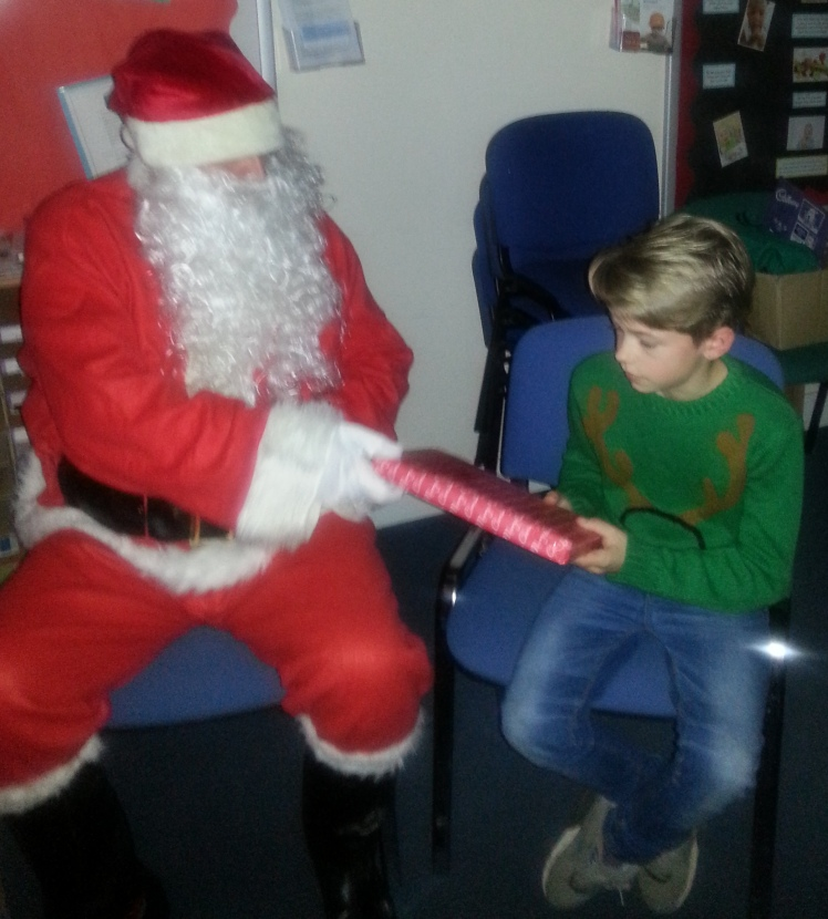 Father Christmas and Finn on Saturday... slideshow of Santa's visit is on the Home Page