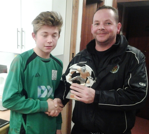 Layton receives the Player of the Match award from stand-in manager Rick Gramson