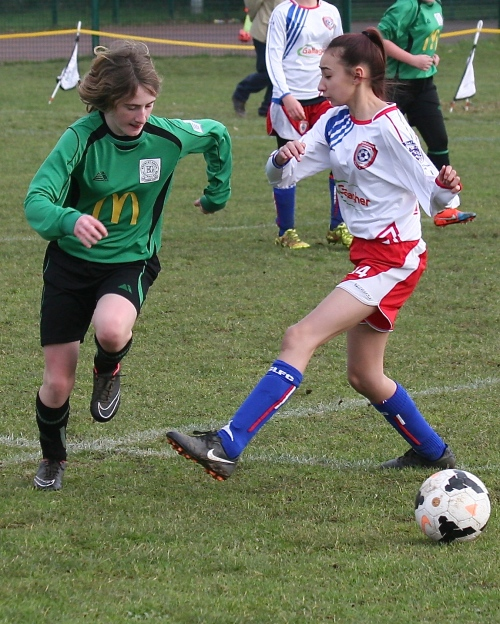 Green on the attack against a plucky Meridian Girls team