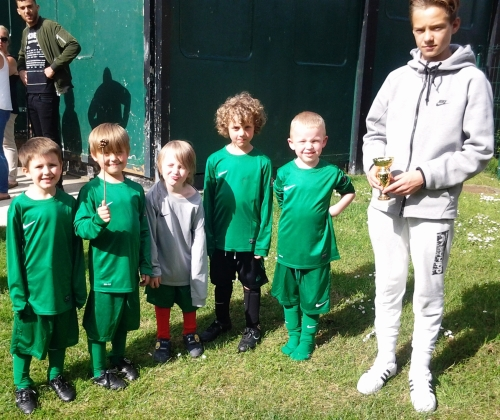 Charlie George with the U7s after their first-ever tournament