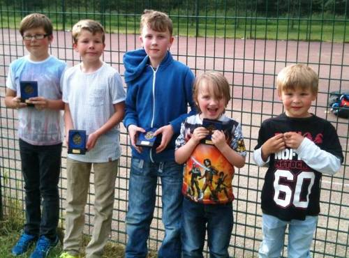 Bromley Green Little Ones proudly show their trophies