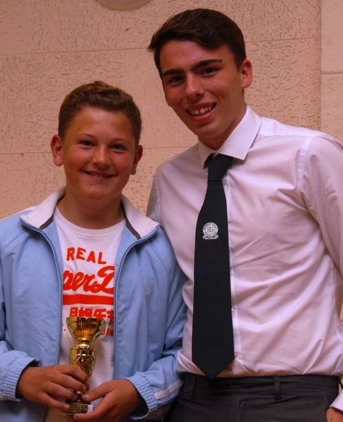 Louis May receives the U13 Colts Endeavour Award from Ryan Ford