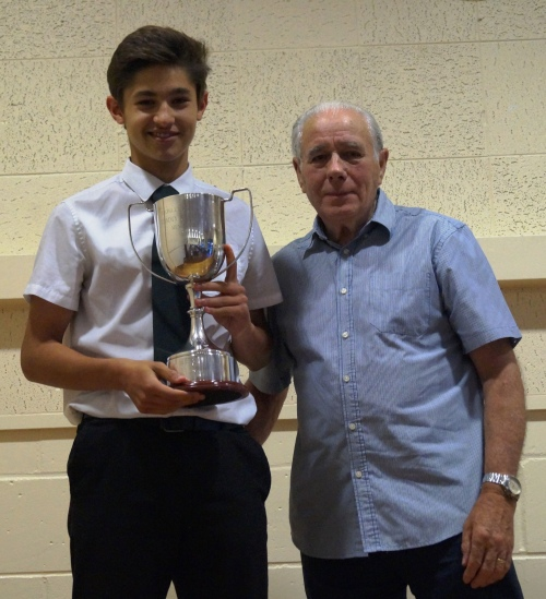 Amir receives the coveted Tommy Stafford Memorial Trophy from Green legend Jack Stafford