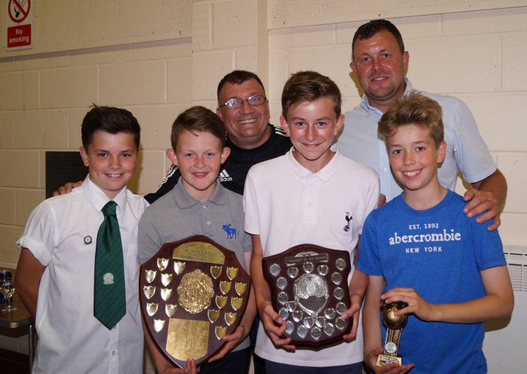 A wonderful double season comes to an end as Zac, Sonny, Charlie and Jack of the U13s celebrate with Ian and Martin