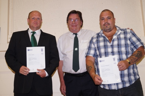 Phil Castle and Thomas Habgood receive their FA Coaching Certificates from Stan Donald