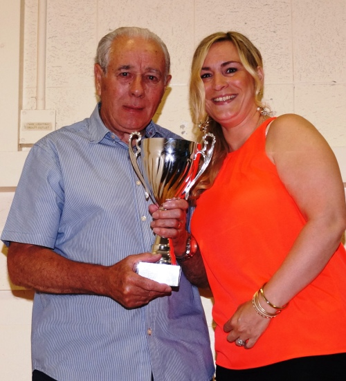 Green legend Jack Stafford receives the Ernie Wedge Memorial Cup for Supporter of the Year from Anne Wedge