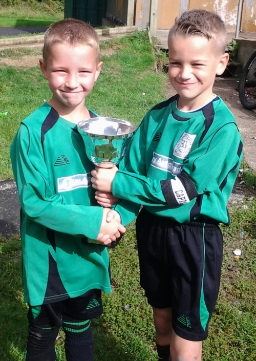 U9s Player of the Match Connor and captain Joe