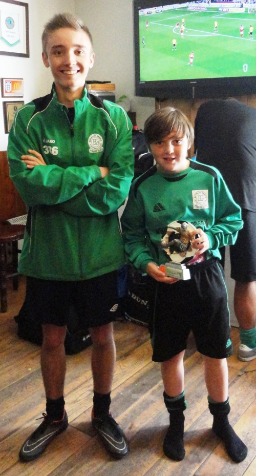Hitting top form were the U11s ... here manager Sam Phelan is with PoM Mickey Mabb