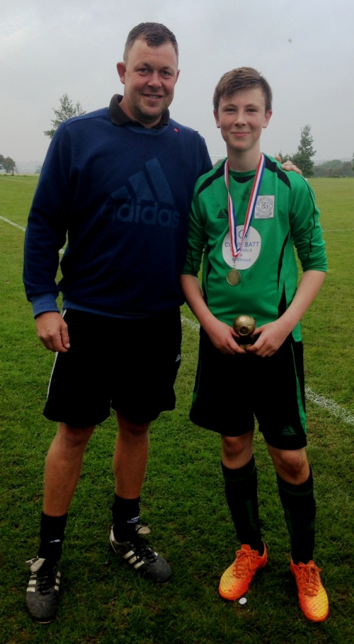 Ollie Heard, a big part of our future, was amongst the goals at Hawkinge and is seen here with Martin receiving the PoM award