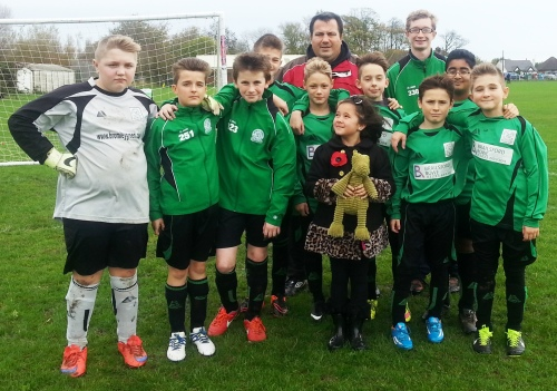 The triumphant U12s with lucky mascots Chelsea and Wilf the Crocodile