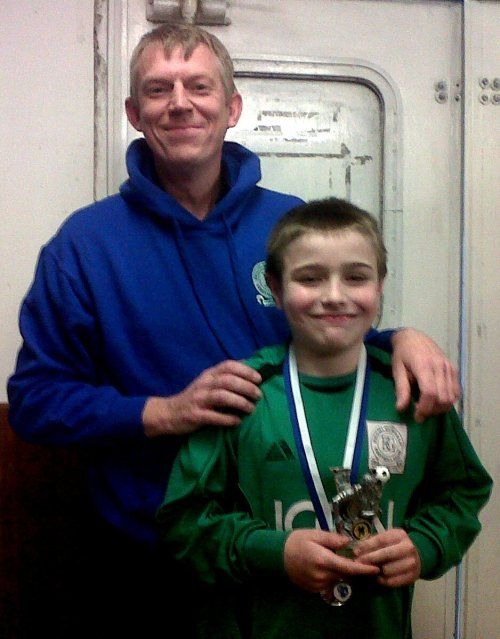 Hoody boy Pat with BGV U11s Player of the Tournament, Oliver 'Twisty'