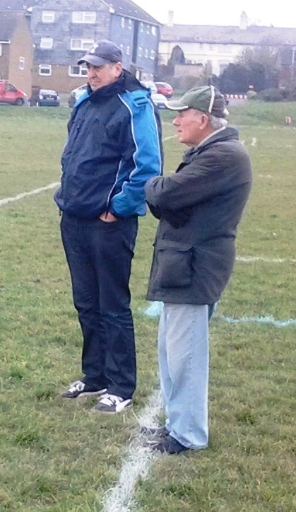 Two winners of the Ernie Wedge Supporter of the Year Award, Fred Moon and Jack Stafford, watch the seniors v Willesborough Res