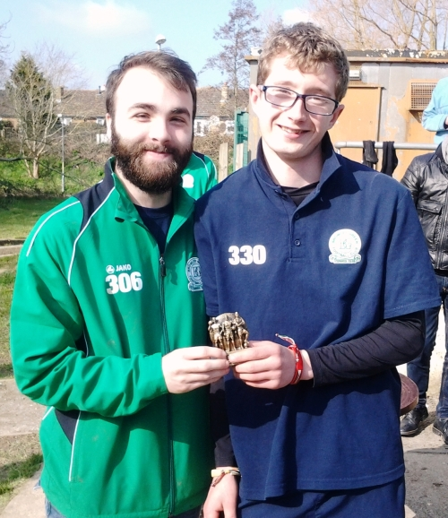 Charlie, who boats 77 assists so far this season, receives the Player of the Tournament award from Stewart Blake