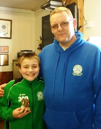 A delighted Oliver with U11s coach Nick
