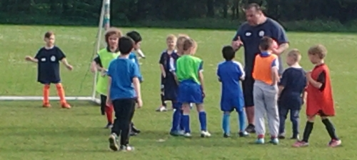 The U7s and U8s enjoy the training