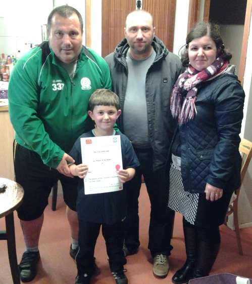 Aiden and proud parents with the McDonalds voucher for our Player of the Tournament for the U7s