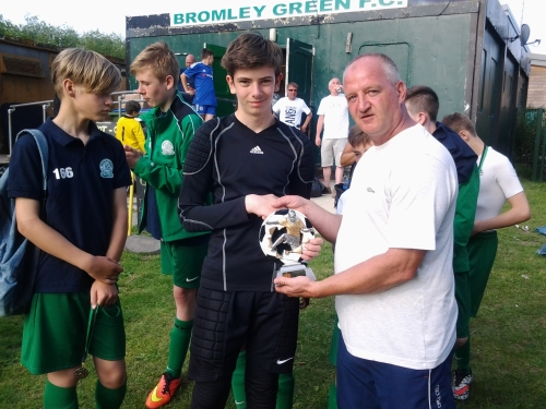 Nathan McHugh receives the U13s Player of the Tournament award from manager Rob Finn